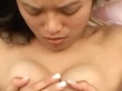 Oriental sweetheart engulfing pecker and getting her face overspread in sex cream