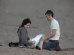 Couple on the beach gets spied on having sex during daytime