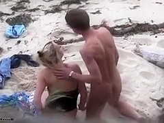 Pair fucking on the beach