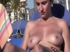 Sexy blonde girl with fake boobs