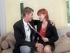 Saggy titted mature redhead.