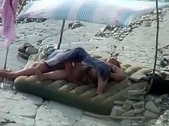 Amateur couple is having sex on the beach