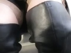 Playgirl in nylons and dark leather boots in a bus