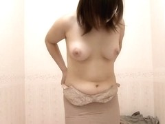 Chubby Japanese girl wearing some tight lingerie