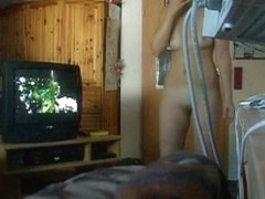 Hidden camera shooting a naked babe changing after shower