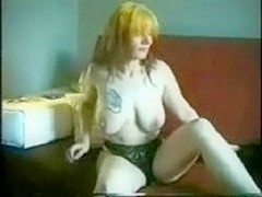 Tattooed mature stripping