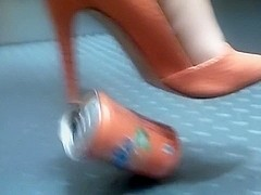 Orange pumps and barefoot