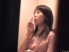 Spy cam caught a spicy Japanese babe masturbating in the toilet