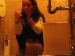 Young girl hunkering while pissing spied by voyeur camera
