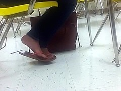 Blonde shoeplay in class