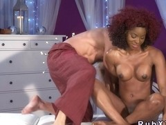Busty ebony gets interracial massage and fuck