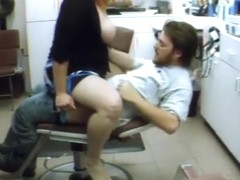 Busty woman penetrated by her man in the salon chair