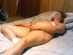 My free homemade mature porn shows me getting mouth-fucked. I'm lying on the bed, with a cock in m.