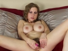 Sausha Packer fucks her hairy pussy with a vibrator
