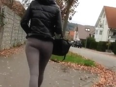 Blonde woman wearing dark grey leggings