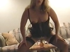 Amazing lady in sexy lingeried toying her cunt with a dildo