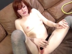 Lustful redhead Kira Lake fucks a hard stick and plays with sex toys