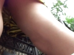 Voyeur upskirt scene with a hot white lady in the street