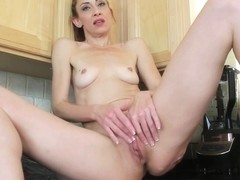 Slim hot Mother I'd Like To Fuck Betty Blaze masturbates in the kitchen