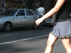 Girl with a short skirt crossing the road on cam