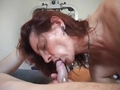 Old red haired bitch fucks in a gym