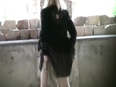 Blonde pissing abandoned place