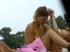Just two sexy hottie undressed at the beach exposing their love bra buddies
