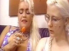 Blond lesbos fuck every other with dildos