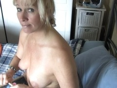 Sexy mature with natural breasts washes away her makeup