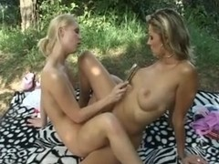 Sexy lesbians outdoor with toys