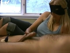 Blindfolded blonde lubes up her man's cock and gives him a handjob, until cumshot.