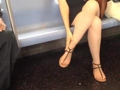 Candid girl crossed legs and flawless feet