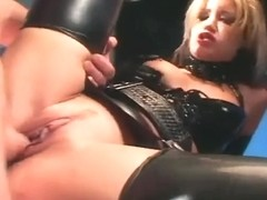 Uniformed female fucking in latex underware