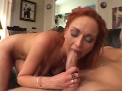 Red-headed bitch gored by white dick in the living room