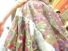 Colorful skirt is moving her ass down the street on the vid