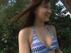 Yukiko Suo gets fucked by two guys at the beach.