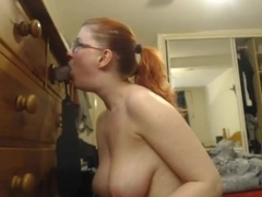 Camslut with glasses deepthroats and facefucks dildo