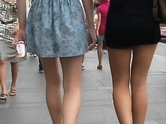 A voyeur takes upskirt shots while walking in the streets
