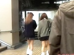Japanese schoolgirls in a kinky street sharking video