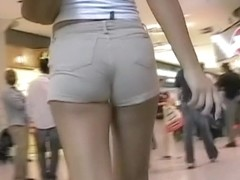 Wonderful girl with long legs and sexy butt on the escalator