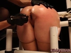 Gagged submissive lesbo toyed