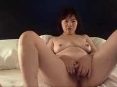 Horny Japanese milf  Kui Somya  masturbation watching video