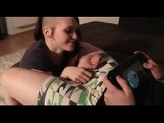 Punk chicks blows her boyfriend while he's gaming