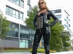 Sexy blonde lady black shiny latex catsuit