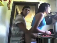 Ponytailed latina girl gets doggystyle fucked, while she cuts tomatoes in the kitchen.