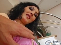 This sexy brunette orally services three guys.
