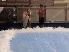 Sexy flowrider is demonstrating her downblouse in aqua park