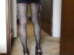 Upskirt in micro mini and black pantyhose