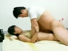 Asian girl makes a sextape with her man on the floor