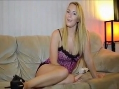 Cute blonde sweetheart on the couch instructing on anal masturbation